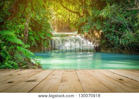 Wood table and Kuang Si waterfalls in Luang Prabang Laos.
