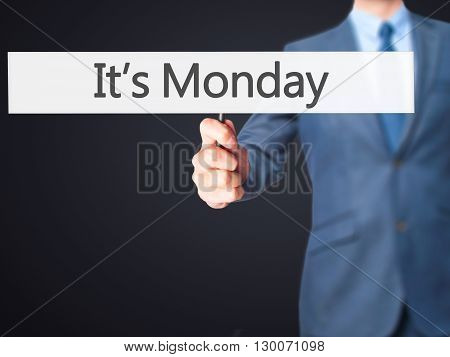 It's Monday - Businessman Hand Holding Sign