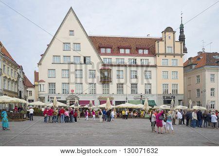 TALLINN, ESTONIA - JUNE 07, 2014: Cloudy day of the Town hall square. Tourist  landmark of the Tallinn, Estonia