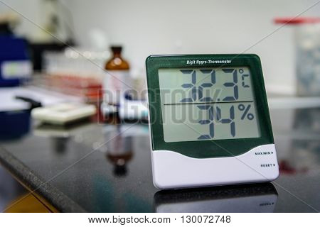 Digital hygro thermometer on table in laboratory