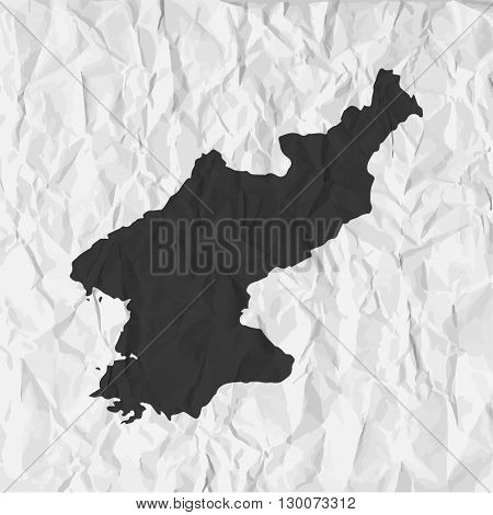 North Korea map in black on a background crumpled paper