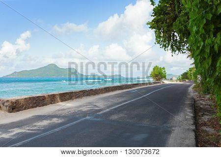The road along the ocean's beach, Mahe, Seychelles.