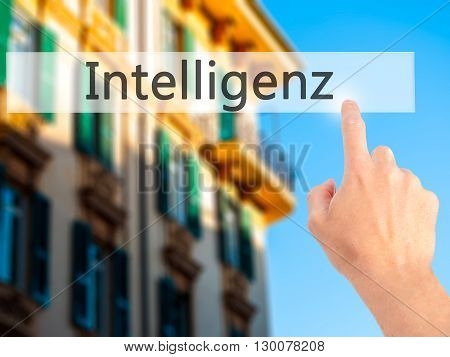 Intelligenz (intelligence In German)   - Hand Pressing A Button On Blurred Background Concept On Vis