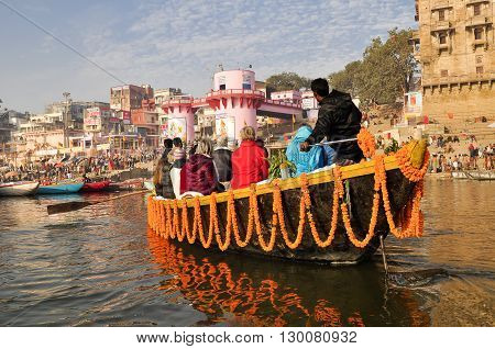 VARANASI, INDIA - DECEMBER 27: ceremony in ganga river on December 27, 2013 in Varanasi.