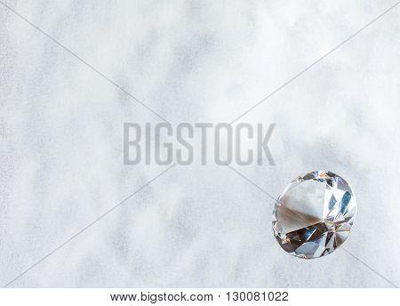 Big cut diamond on a white sugar background.