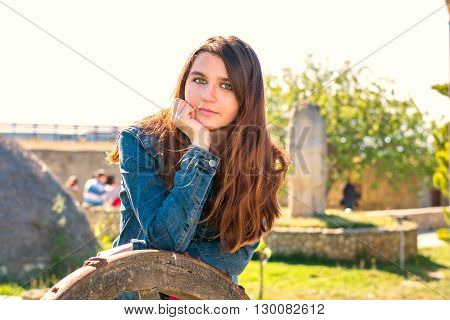 Young Beautiful Brunette Woman With Long Hair Near A Chariot