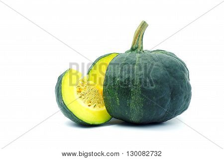 A yellow piece of pumpkin and green pumpkin on white background. A yellow sliced pumpkin and green pumkin on white background.