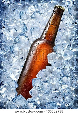 Brown bottle in ice isolated on white