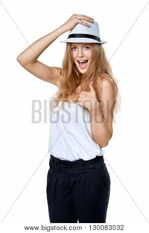Happy excited woman with straw hat laughing at camera gesturing thumb up
