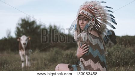 Beautiful ethnic indian lady with roach on her head.