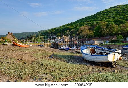 Boats on the shore at Porlock Weir a pretty fishing villlage on the Exmoor coast in Somerset