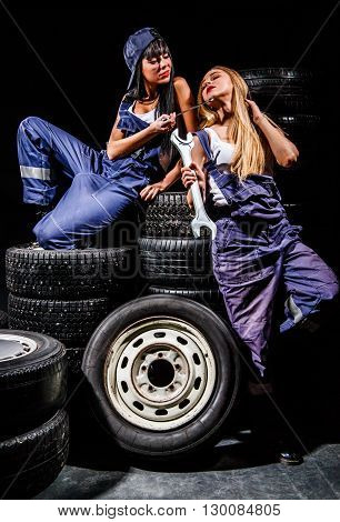 Sexy Young Women Sitting On A Tires