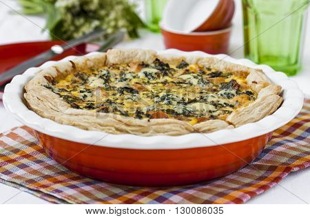 quiche with salmon nettles sorrel and cheese