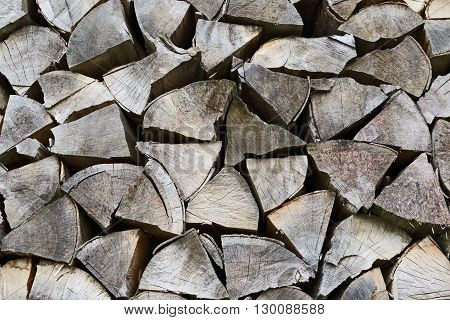stack of dry wooden logs for the fire