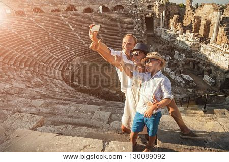 Family vacation selfie photo in antique amphitheater in SideTurkey