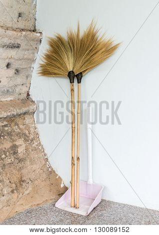 Double broom with dustpan for cleaning the house.