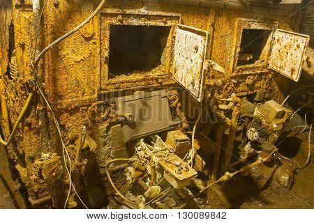 Old rusting mechanical boiler in wet basement
