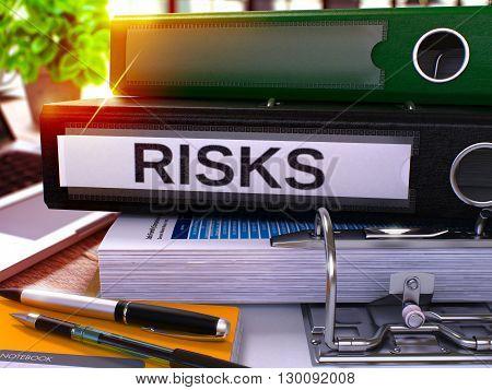 Risks - Black Ring Binder on Office Desktop with Office Supplies and Modern Laptop. Risks Business Concept on Blurred Background. Risks - Toned Illustration. 3D Render.