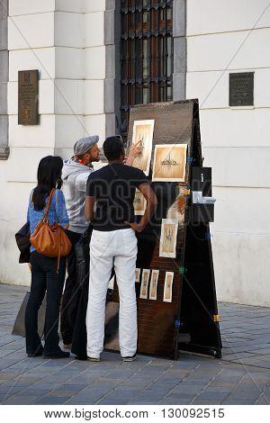 BRATISLAVA, SLOVAKIA - MAY 16, 2016: Artist selling his work in the streets of Bratislava, Slovakia on May 16, 2016.