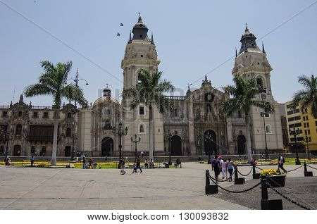 Lima, Peru - December 31, 2014: View of the cathedral church and the main square Plaza Mayor (formerly Plaza de Armas) in the down town.