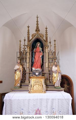 SVETI MARTIN POD OKICEM, CROATIA - SEPTEMBER 16: Altar of the Virgin Mary in the church of Saint Martin in Sv. Martin pod Okicem, Croatia on September 16, 2015.