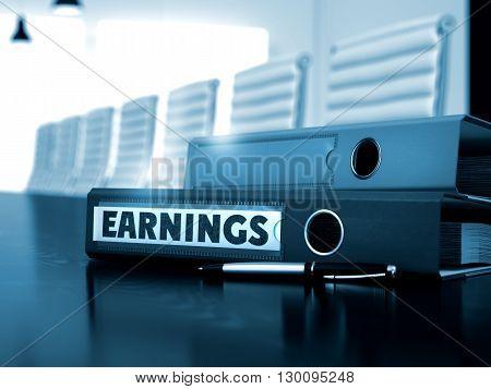 File Folder with Inscription Earnings on Black Desktop. Earnings - Illustration. Earnings - Business Concept on Blurred Background. Earnings - Binder on Wooden Working Desk. 3D Render.