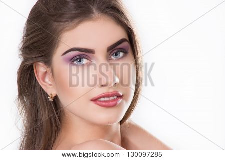 close up - a face of the young beautiful woman. isolated on a white background