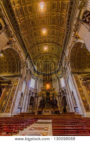 VATICAN, ITALY - JUNE 13, 2015: Altar inside Saint Peter basilica in Vaticano, nobody on the red chairs. Large beautiful hall,