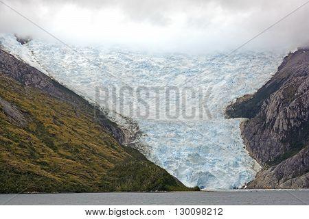 The Italian Glacier coming out of the Clouds in Glacier Alley of Tierra del Fuego