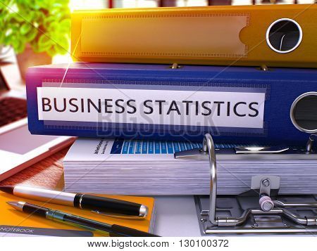 Business Statistics - Blue Office Folder on Background of Working Table with Stationery and Laptop. Business Statistics Business Concept on Blurred Background. Business Statistics Toned Image. 3D.
