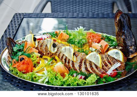 Stuffed Pike Decorated With Vegetables And Fruits With The Greens. Very Beautiful Restaurant Dish