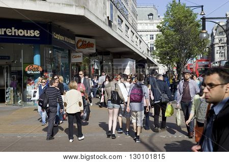 LONDON, UNITED KINGDOM - OCTOBER 16, 2015: Crowded sidewalk on Oxford Street with tourists from all over the world.