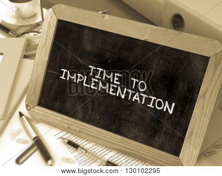Time to Implementation Concept Hand Drawn on Chalkboard on Working Table Background. Blurred Background. Toned Image. 3D Render.