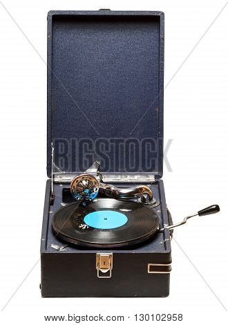 Gramophone with a vinyl record on wooden table. Isolated on white background