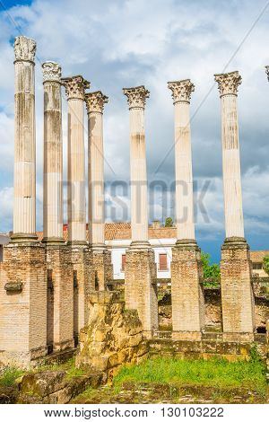 Antique ruins of column part of historical monument in Cordoba village, Andalusia