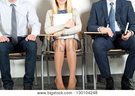business people sitting and waiting for job interview