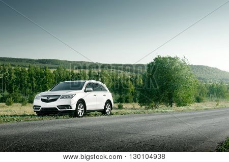 Saratov, Russia - August 11, 2015: Modern car Acura MDX standing on road at sunset