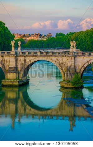 ROME, ITALY - JUNE 13, 2015: Sant Angelo bridge on Tiber river only for pedestrians in Rome, you can find ten angels alng this great building.