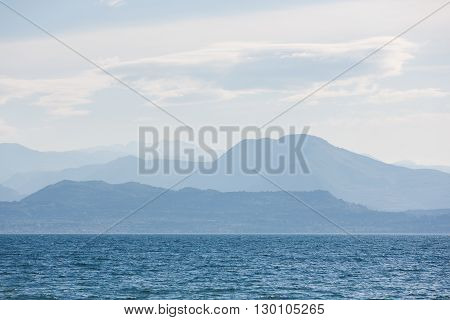 The landscape of Lake Garda with the Dolomite mountains in the background