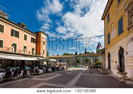 Peschiera del Garda Italy - May 03 2016: View of the San Marco square in pedestrian area of the old town