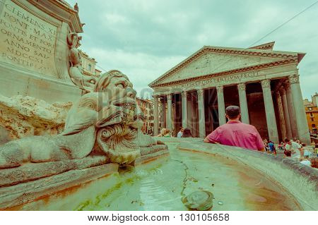 ROME, ITALY - JUNE 13, 2015: Pantheon of Agrippa building view from outside square, fountaine in the middle with unidentified men. Piazza della rotonda.