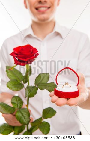 Close Up Portrait Of Man With Rose And Wedding Ring Going To Make Proposal