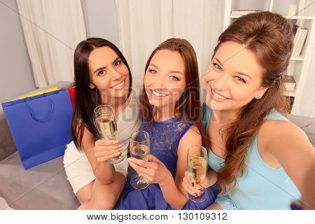 Pretty Women Sitting On Couch With Wine And Making Selfie