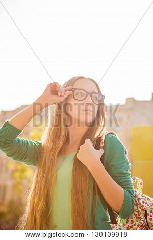 Portrait Of Beautiful Tourist In Glasses Having Excursion In City