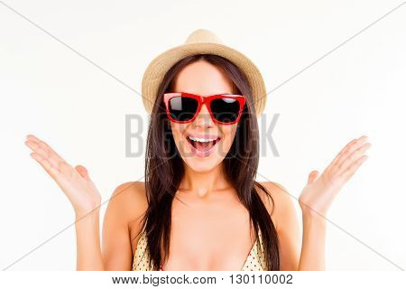 Portrait Of Pleasantly Surprised Brunette In Summer Hat And Spectacles