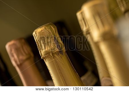 Sealed and foiled bottles of wine or champagne