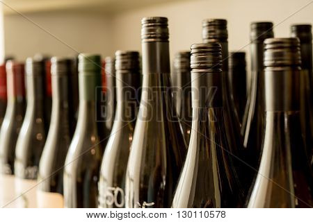 Rows of unlabeled and unopened bottles of wine