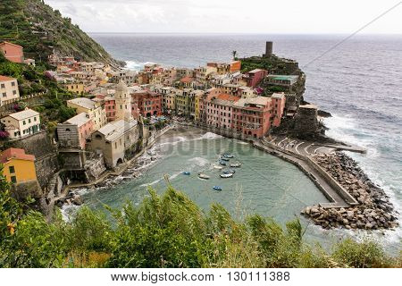 View of an Italian fishing village with colored houses and the harbor on a rainy day.
