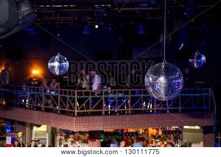 Blue disco background with mirror balls and lights