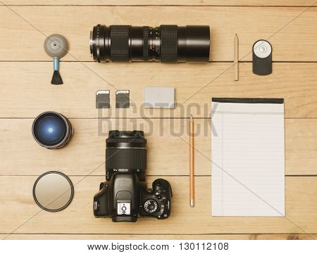 Photographer accessories in flat lay shot, wood table